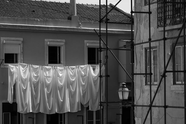 Black & White Lifestyle Portugal Architecture Black And White Blackandwhite Building Exterior Built Structure Clothesline Clothing Contrast Drying Hanging House Lifestyles Lighting Equipment Lisboa Lisbon No People Outdoors Pattern Residential Building Sheet White Window