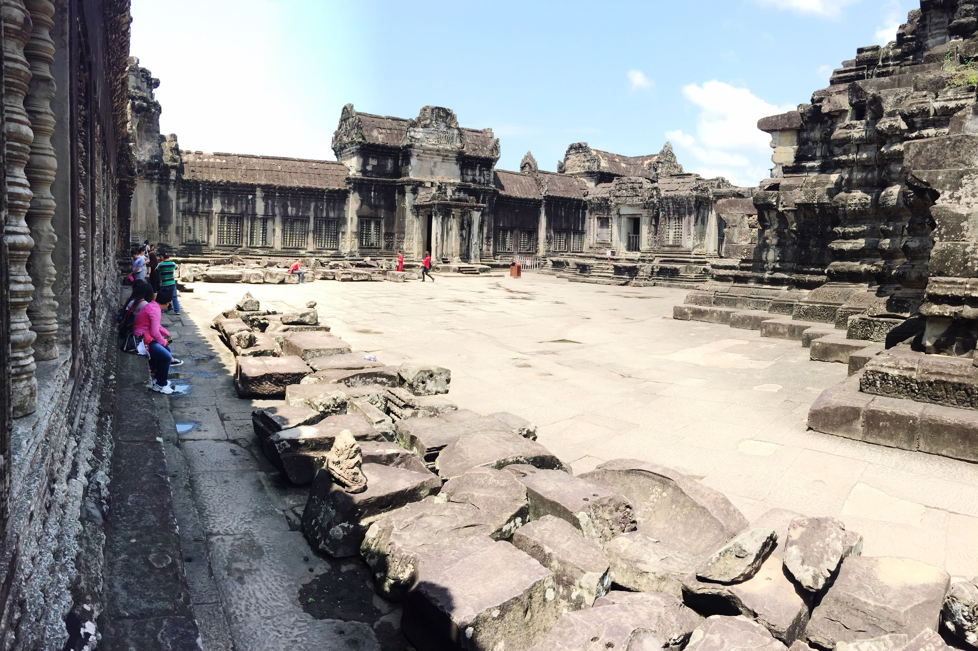 built structure, architecture, building exterior, person, men, sky, travel, travel destinations, famous place, the past, in front of, old ruin, tourism, history, ancient, group of people, architectural column, stone material, colonnade, outdoors, day, unesco world heritage site, place of worship, cloud - sky, historic, ancient civilization