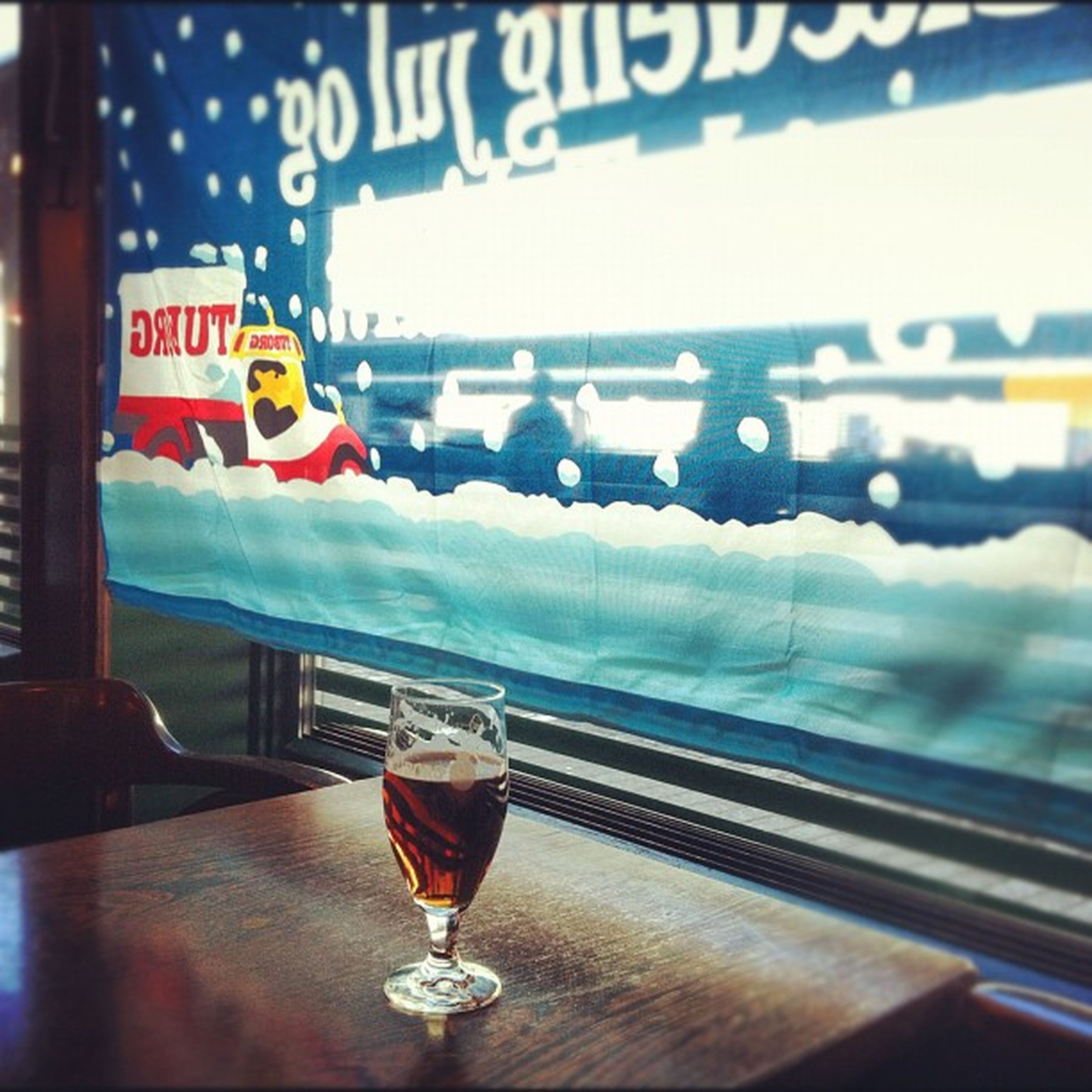 indoors, text, glass - material, transparent, western script, communication, focus on foreground, close-up, table, water, transportation, window, reflection, vehicle interior, no people, selective focus, glass, refreshment, drink, still life