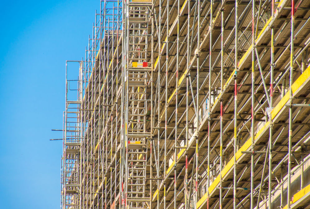 Construction Construction Site Architecture Blue Build Building Buildings Clear Sky Construction Work Day Falsework Framework Lot No People Outdoors Scaffold Site Sky
