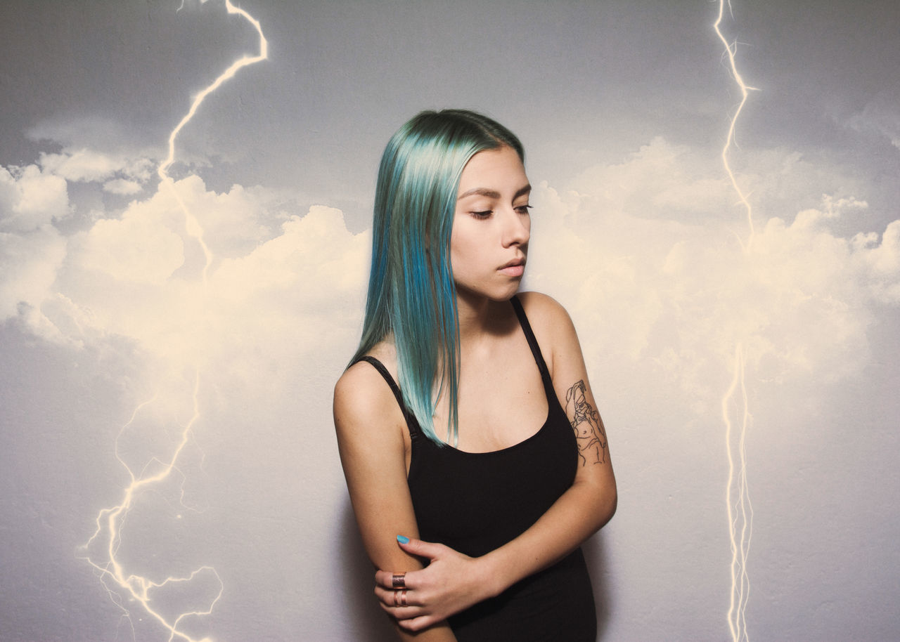 Beautiful stock photos of blitz, cloud - sky, young women, young adult, one person