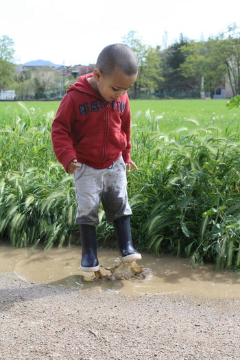 Jamp! Jamp Kids At Play Kids Photography Kidsphotography Kids_of_our_world EyeEm Gallery Nature Photography Kids Kid Nature Photography Children Play Water Eyeemphotography Happy Puddle Puddleography Showing Imperfection