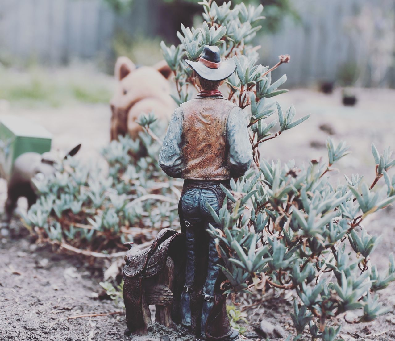 Real People Focus On Foreground One Person Day Outdoors Growth Field Nature Close-up Camouflage Clothing Muttlypictures Cowboy Man Pissing Toys Toystory 1960's Western Toy Horse Toy Donkey Color