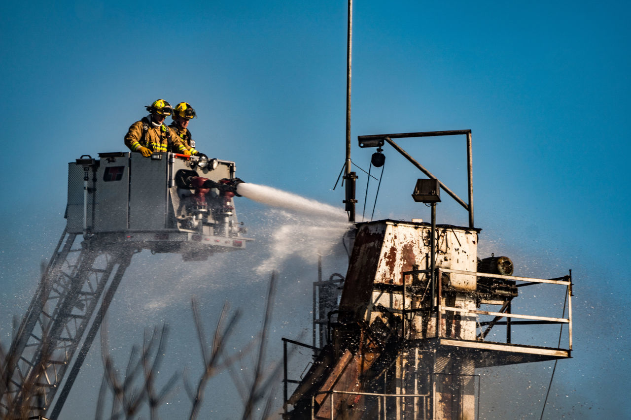 Putting out a fire at the top of a building Disaster Fire Fireman Industry Manual Worker Outdoors Working