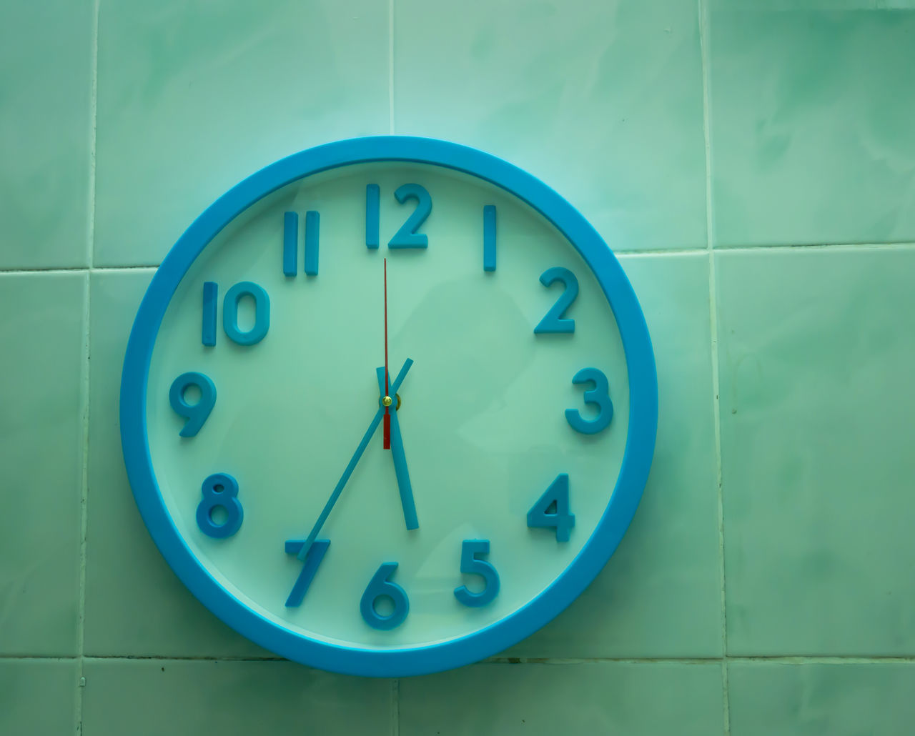 wall - building feature, blue, number, clock, time, minute hand, no people, indoors, day, close-up, hour hand, clock face