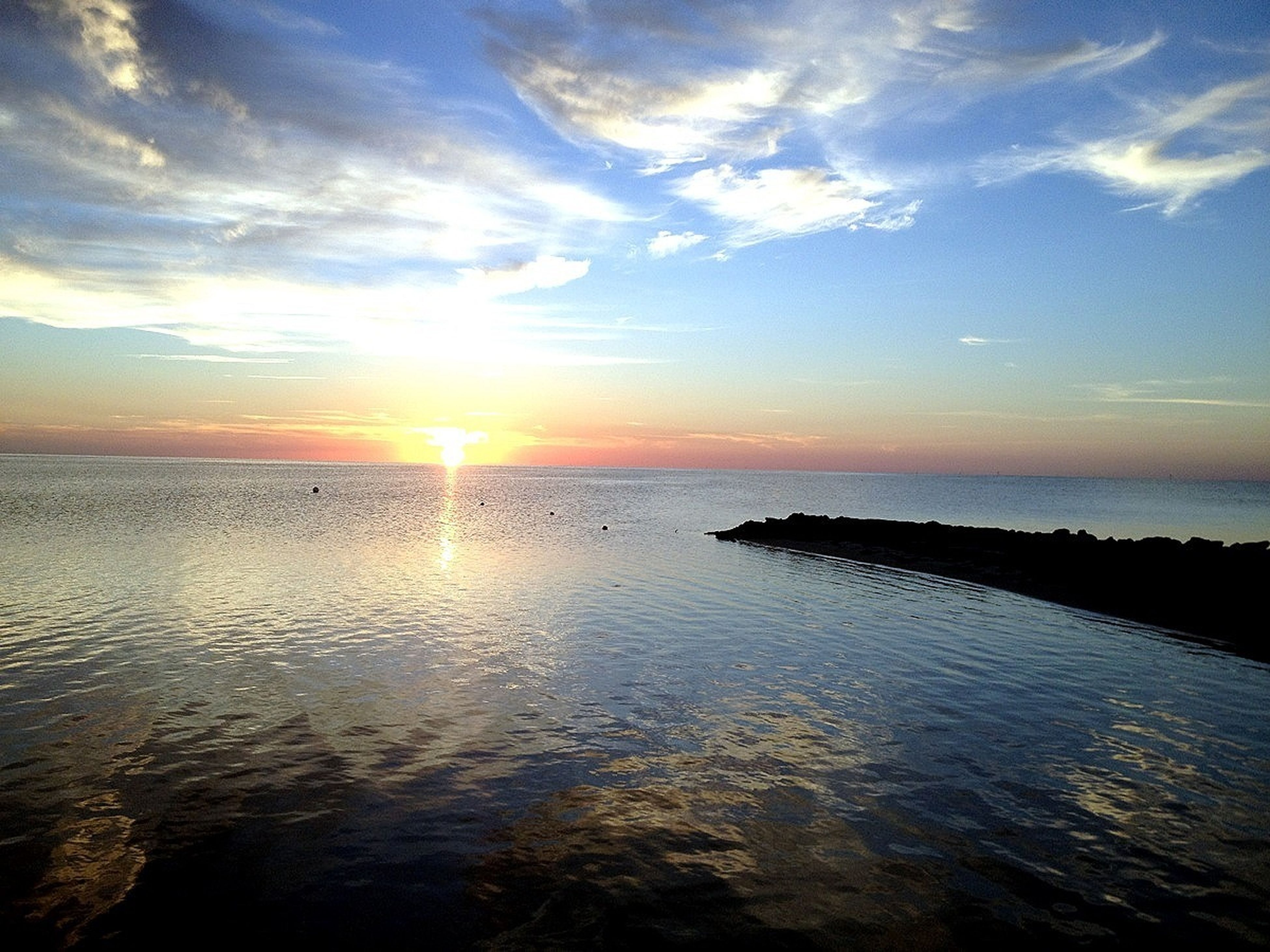 water, sea, sunset, horizon over water, tranquil scene, scenics, tranquility, sky, beauty in nature, reflection, sun, idyllic, nature, waterfront, cloud - sky, cloud, sunlight, rippled, orange color, silhouette