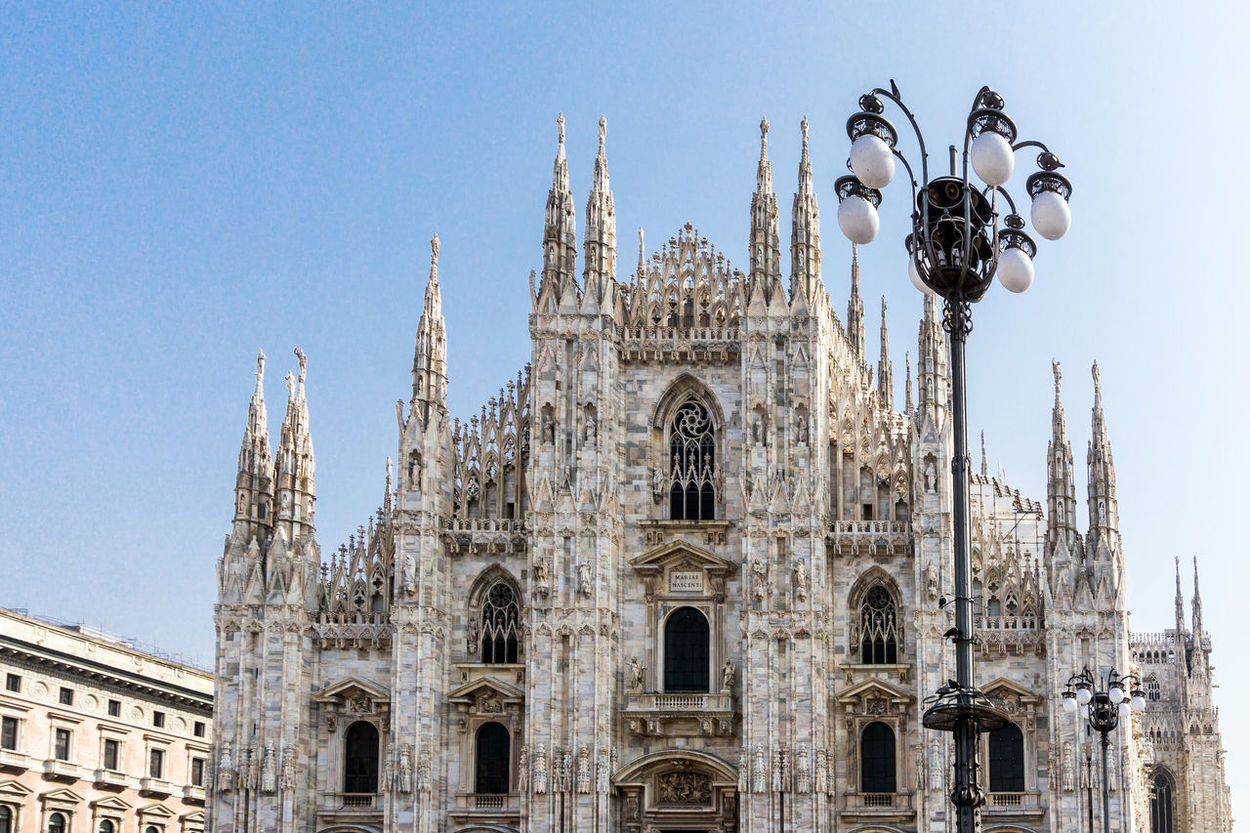 Europe Trip Milan Cathedral Travel Architecture Baroque Style Building Building Exterior Built Structure Clear Sky Cross Day History Landmark Low Angle View No People Outdoors Place Of Worship Religion Sky Spirituality Statue Street Teavel Destination Tourism Travel Destinations