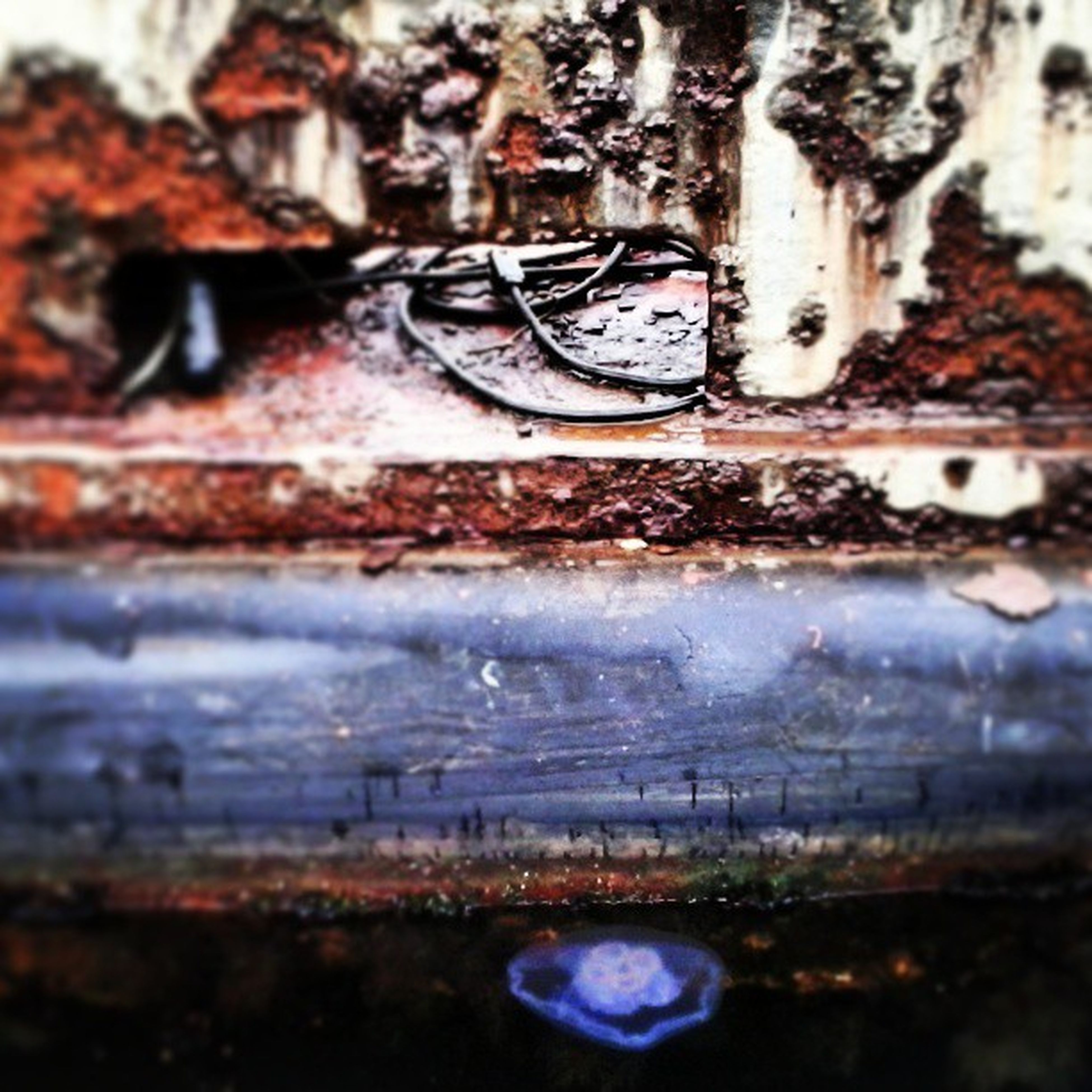 water, wet, architecture, close-up, built structure, selective focus, focus on foreground, drop, rain, building exterior, reflection, outdoors, day, no people, metal, rusty, raindrop, window, transportation, puddle