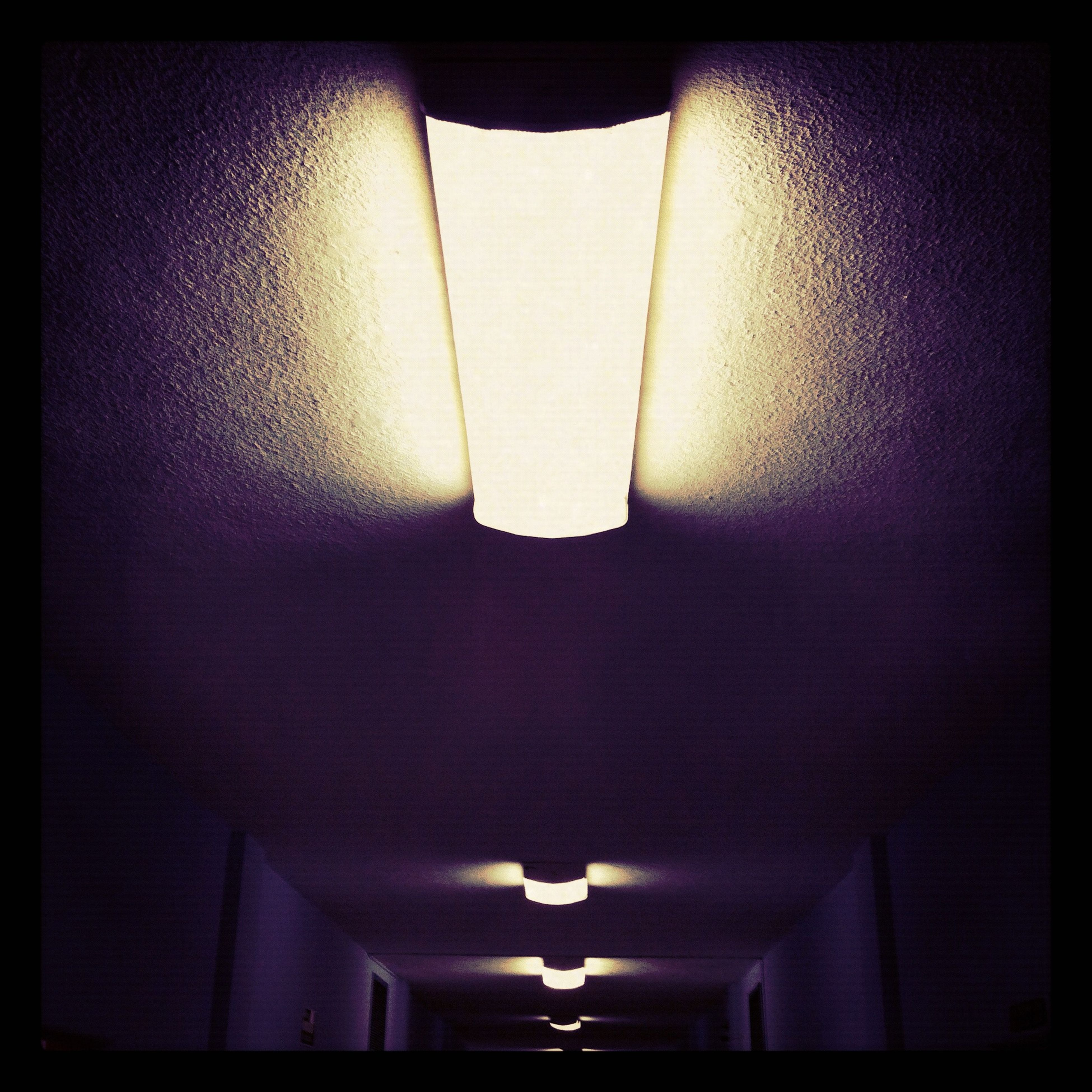 indoors, illuminated, lighting equipment, low angle view, ceiling, hanging, electric lamp, built structure, architecture, electricity, auto post production filter, light - natural phenomenon, transfer print, wall - building feature, electric light, no people, decoration, lamp, home interior, light