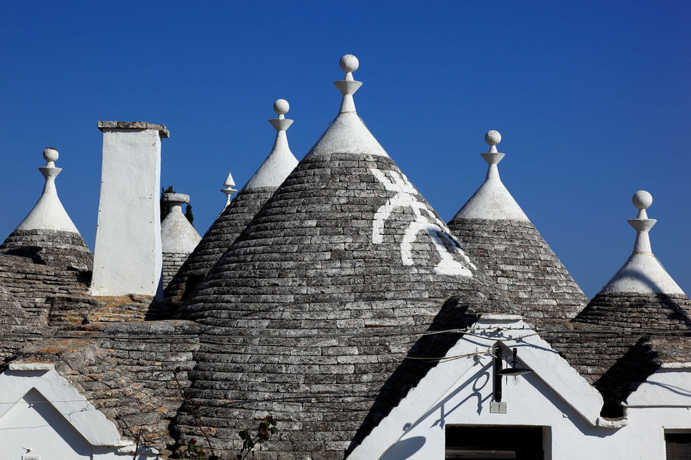 Alberobello, Trulli, Apulia, Italy Alberobello Ancient Architectural Feature Architecture Building Exterior Built Structure Day High Section History House Italy Low Angle View National Landmark No People Outdoors Puglia Tourism Travel Destinations Traveling Travelphotography Trulli Houses Trullo Trullo Di Albero Bello