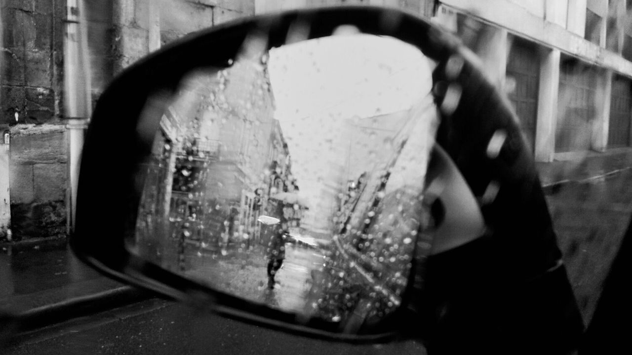 drop, wet, window, land vehicle, water, glass - material, close-up, transportation, transparent, mode of transport, focus on foreground, freshness, stationary, extreme close-up, person, city life