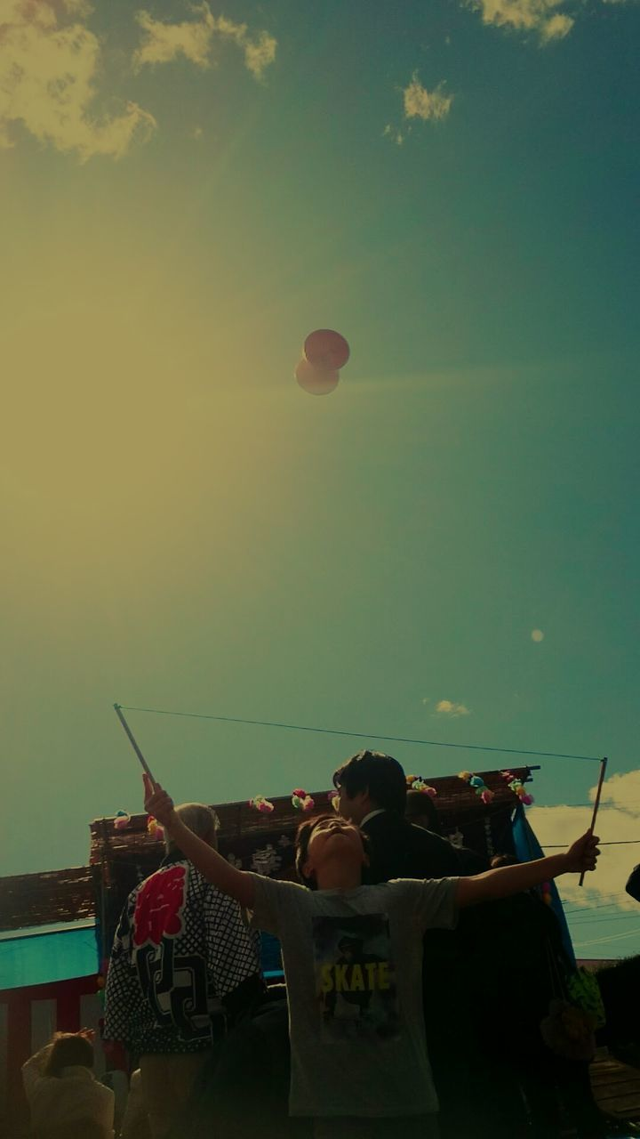 real people, men, leisure activity, lifestyles, togetherness, sky, women, mid-air, large group of people, beach, sitting, sea, outdoors, nature, hot air balloon, day, people