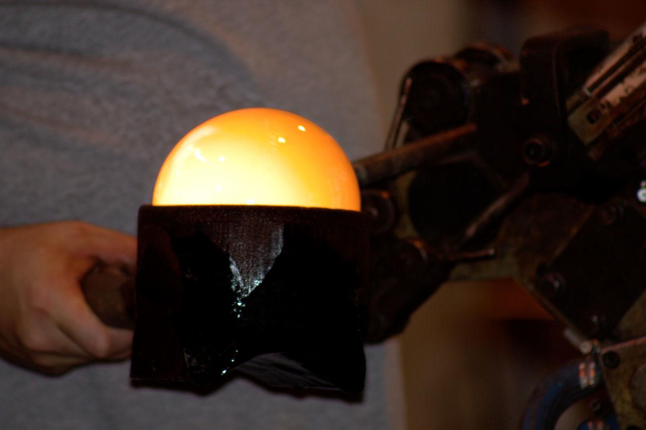 Close-up Glass Globe Shape Hot Maker Making Moulding Yellow Heat