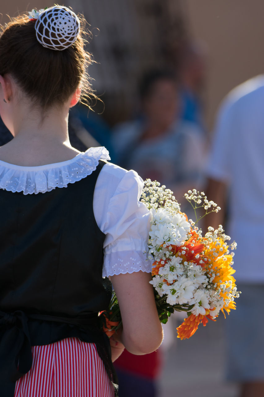 flower, girls, real people, celebration, childhood, celebration event, one person, standing, outdoors, lifestyles, bouquet, child, day, close-up, freshness, bride, people