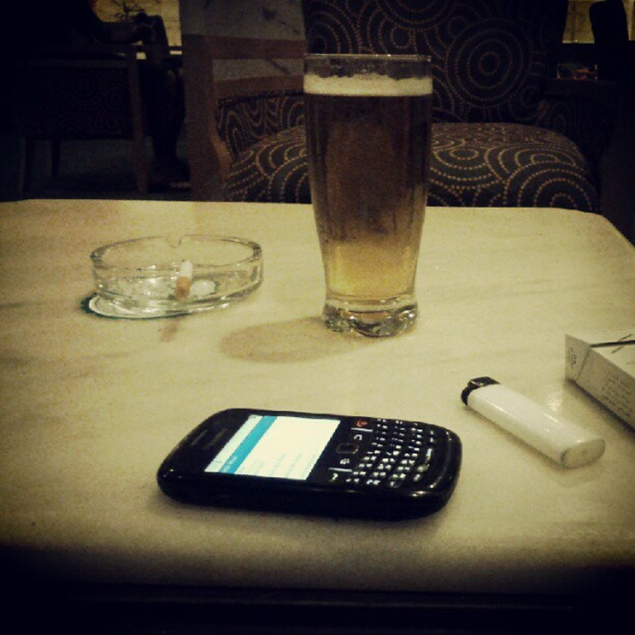table, indoors, wireless technology, food and drink, drink, drinking glass, refreshment, no people, mobile phone, alcohol, technology, close-up, day