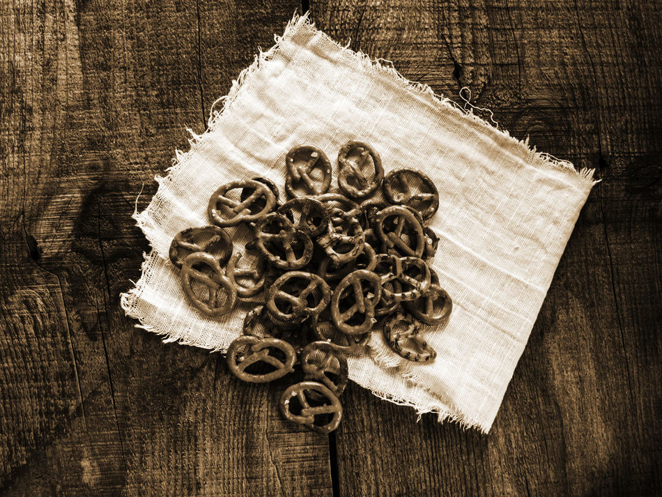 Heap of fresh Wheat salt pretzels on hessian linen fabric cloth and wooden table Circle Close-up Cloth Fabric Fresh Heap Hessian High Angle View Indoors  Linen No People Pretzels Salt Table Wheat Wooden