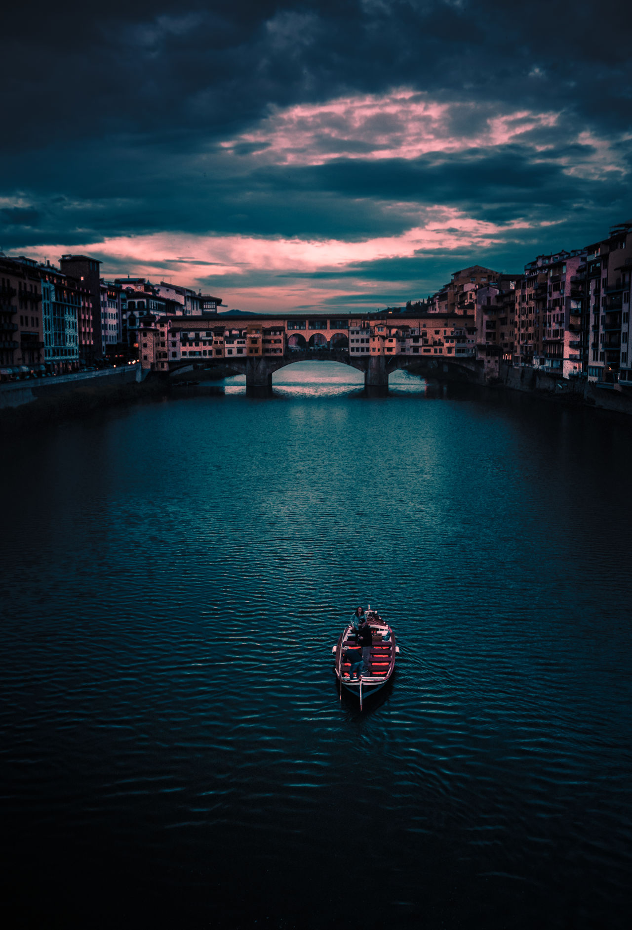 The man on the boat proposed shortly after I took this shot. Pretty class if you ask me.The Architect - 2017 EyeEm Awards People Night Cityscape ArchitectureBuilding Exterior Florence Cloud - Sky Urban Skyline Travel Destinations City Reflection Illuminated Water River EyeEm Best Shots Italy Boat