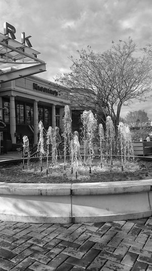 Fountain at South Park Mall in Charlotte, NC Water Fountain Outdoors No People Blackandwhite Blackandwhite Photography Black & White Water Fountain Water Fountain With The Buildings And The Sky Welcome To Black