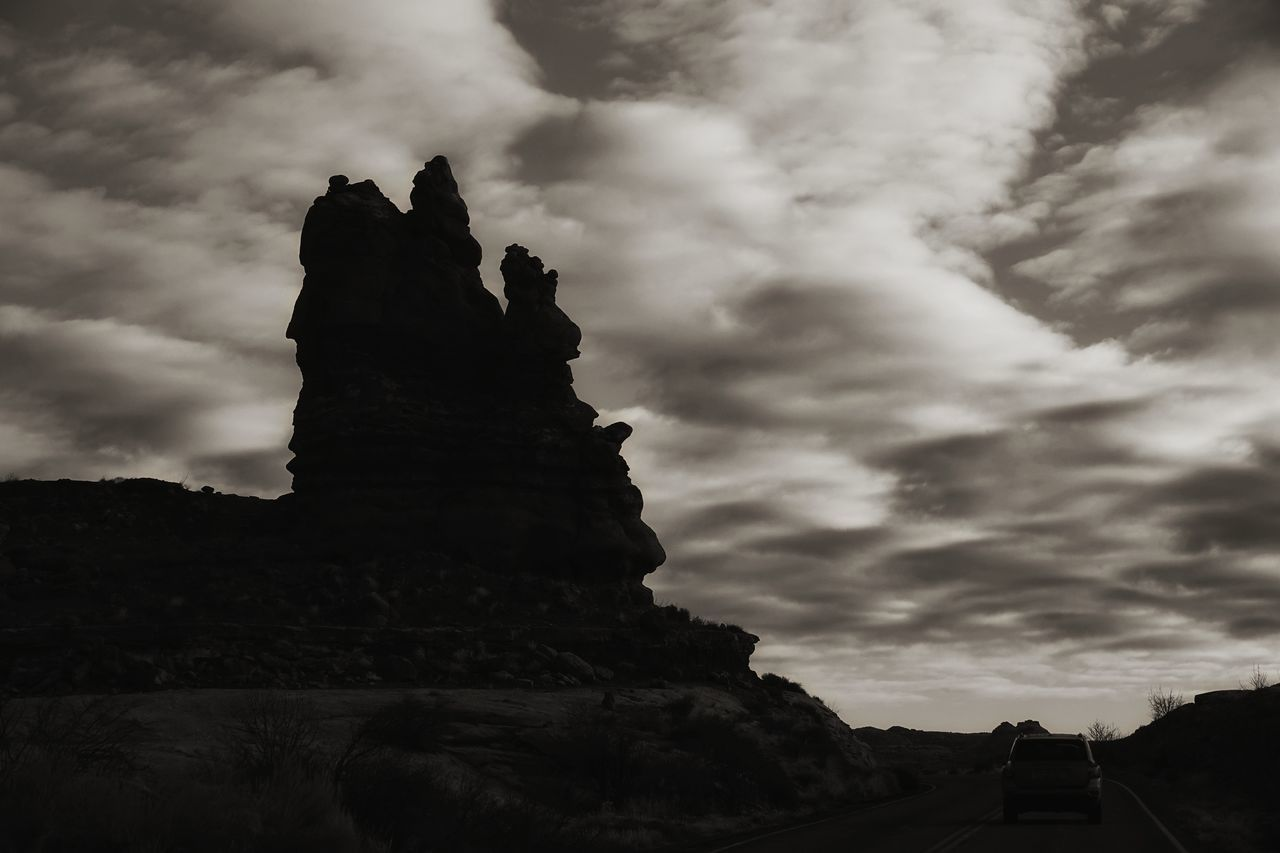USA Photos Cloudpark Cloudporn Bnw Blackandwhite Dramatic Sky Rock - Object Landscape Silhouette Beauty In Nature Travel Destinations No People Outdoors Sky Nature Desert Tranquility Rural Scene Low Angle View Scenics Storm Cloud Road Mountain Landscapes Streamzoofamily