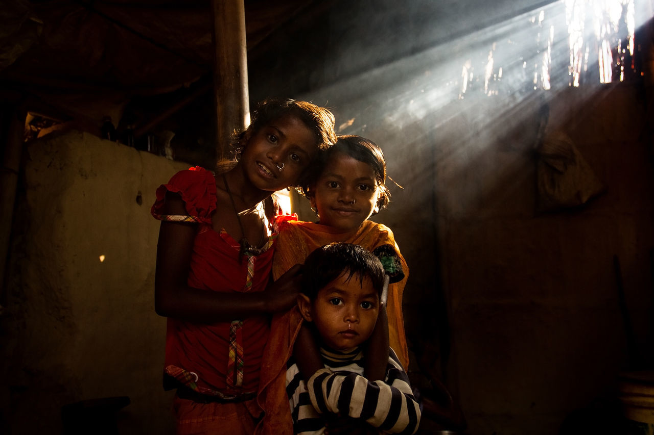 Three sisters looked at the Camera in the morning while morning sunlight lighten up their face. Adult Child Childhood Dark EyeEm EyeEm Best Shots EyeEm Gallery EyeEm Photo Of The Day EyeEmBestPics Indoors  Looking At Camera Males  Night People Portrait Rural Life Rural Lifestyle Rural Scene Siblings Smiling Son Standing Three Kid Togetherness Young Adult EyeEmNewHere EyeEmNewHere Women Around The World Women Around The World