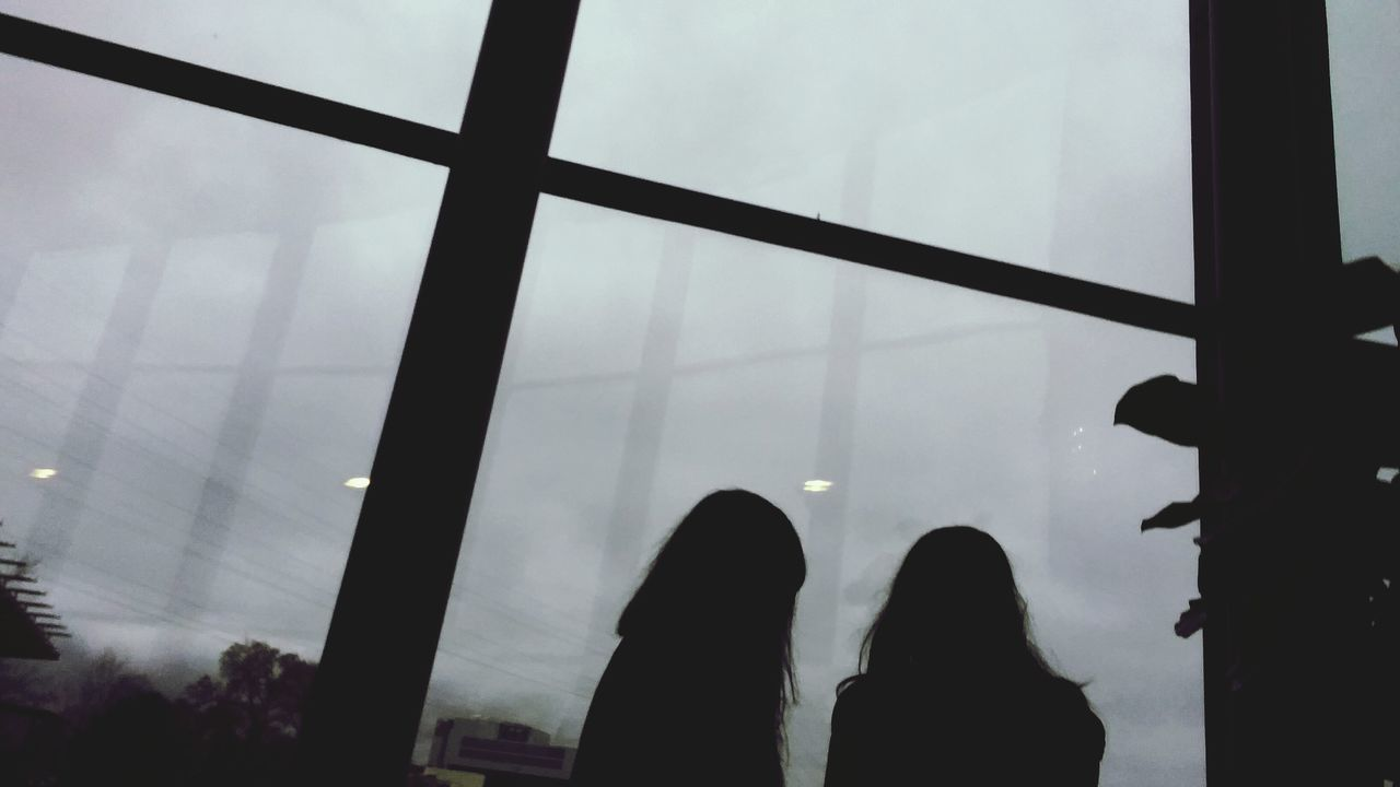 When you accidently take an artsy picture Silhouette Real People Rear View Human Body Part Outdoors People Window Window Frame Glass Windows Glass Reflection Two People Gloomy Gray Day Sky Artsy Abstract Angle Shot Slanted