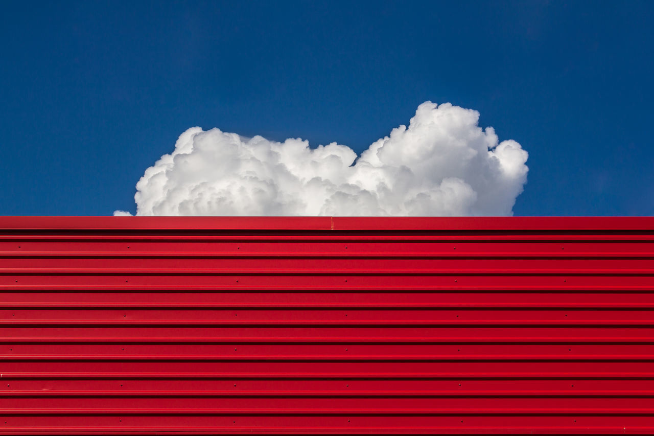 Architecture backgrounds blue building exterior built structure cloud - sky Colors corrugated iron day large Low angle view minimal no people outdoors Red red color sky vibrant color TakeoverContrast Minimalist Architecture Copy Space
