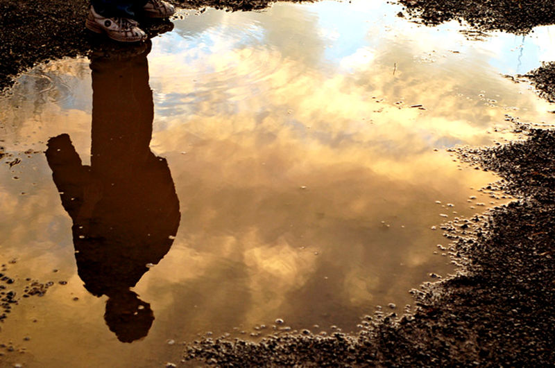 Reflections of a beautiful night. Black Blue Cloud - Sky Clouds Cloudy Day Evening Orange Outdoors Puddle Reflection Silhouette Sky Standing Water Sunset Tranquil Scene Tranquility Water Yellow Showcase July My Son My Reflection Obsession After The Storm