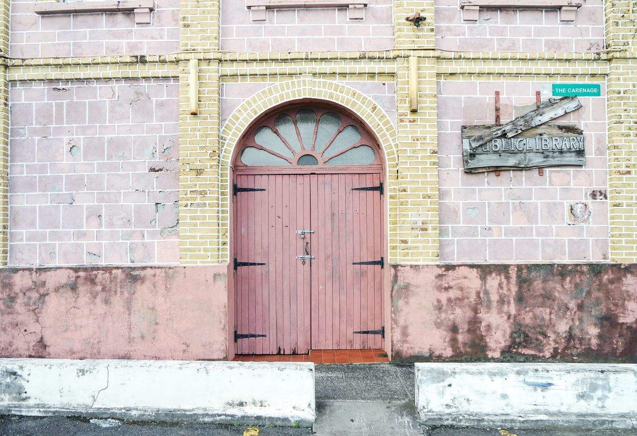Public library in Grenada Building Exterior Door Architecture Built Structure Closed No People Outdoors Day Brick Wall Street Photography Architecture Tourism City Fresh 3 Streetphoto_color Eye4photography  Travel Destinations Open Edit EyeEm Best Shots Doorsworldwide Doorporn Multi Colored Doors Lover