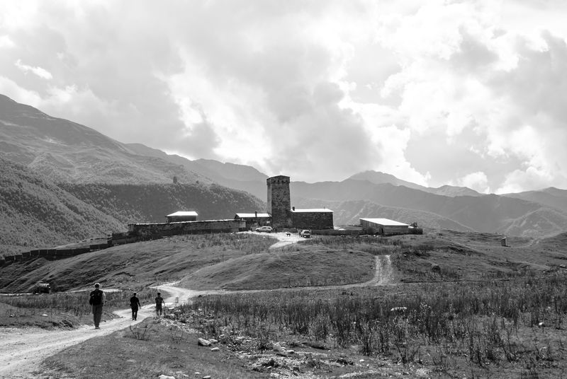 Reaching one of the old defensive towers in Ushguli village. Located in the Great Caucasus mountain range, Georgian Svanetia region. Agriculture Beauty In Nature Blackandwhite Cloud - Sky Clouds And Sky Day Historic Landscape Monochrome Mountain Mountains Nature Outdoors People Sky Svaneti Trekking Ushguli Svanetia Unesco World Heritage Mountain Village Historical Building