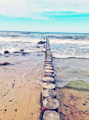 Beach Sand Sea Tranquil Scene Tranquility Horizon Over Water Water Outdoors Scenics Day Nature Beauty In Nature The Way Forward Sky No People Vacations Groyne