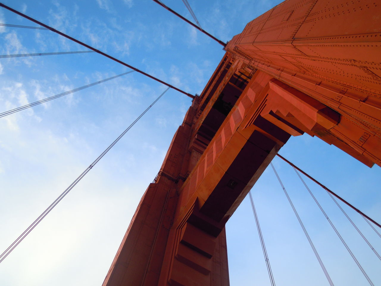 Tiny Humans. Blue Sky Built Structure Cable Connection Construction Engineering Golden Gate Bridge International Landmark Low Angle View Structure Market Bestsellers June 2016 Bestsellers