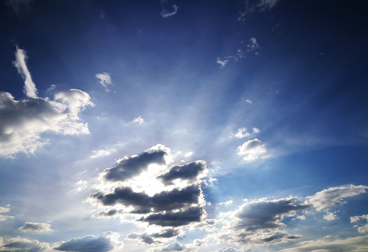 sky, cloud - sky, beauty in nature, nature, blue, sunbeam, low angle view, no people, scenics, sky only, outdoors, backgrounds, sunlight, day