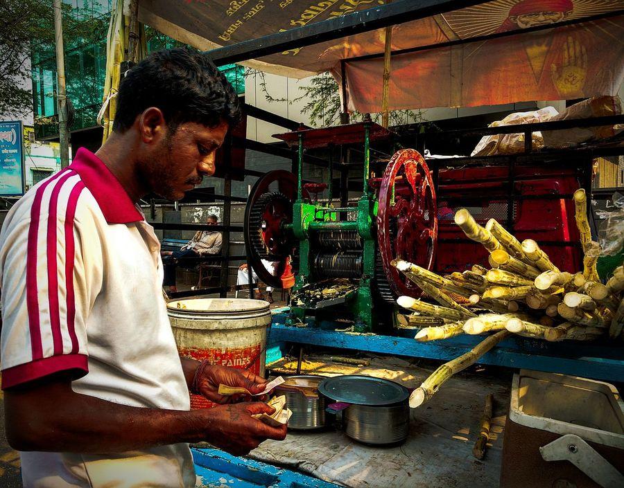 Here Belongs To Me People Photography Street Photography Hard Working Potrait Of Man Man At Work Juice Making Sugarcane Juice Hot Afternoon Juice Machine Counting Money Sugarcane Roadside Stall