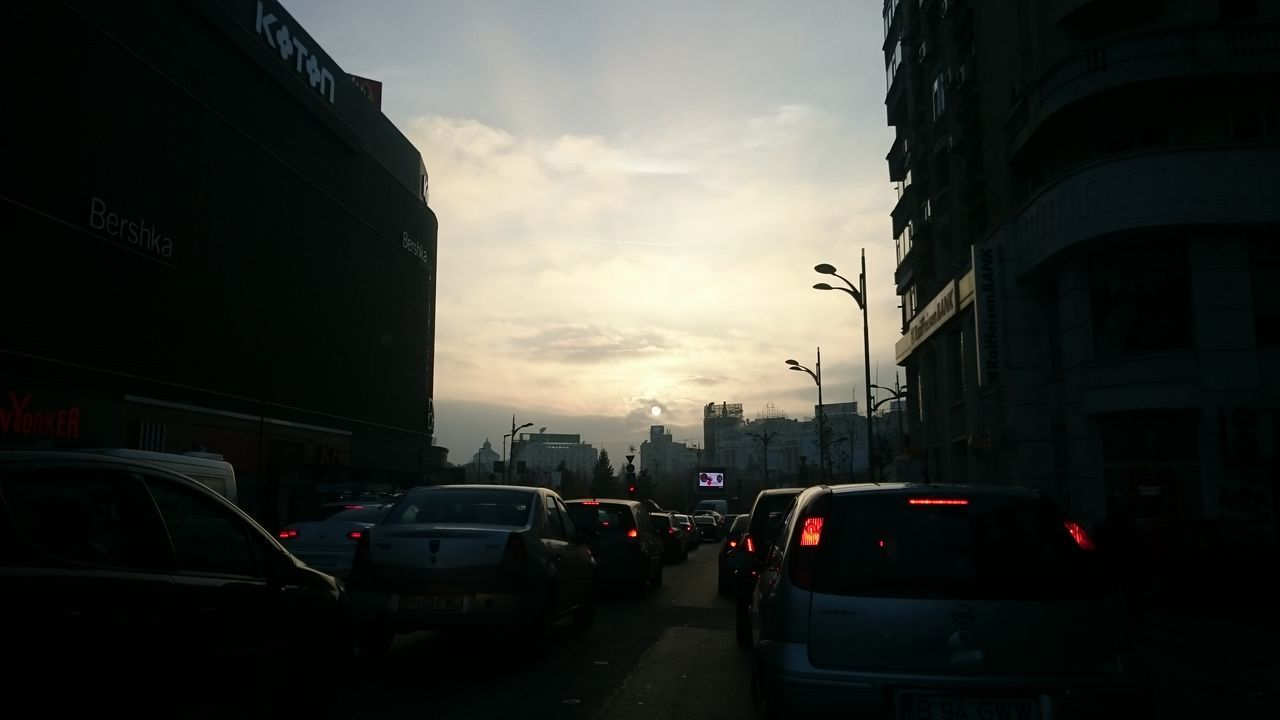 Goodbye sun! Adapted To The City Car City City Life City Street Day Outdoors Red Light Sky Street Sunset Traffic