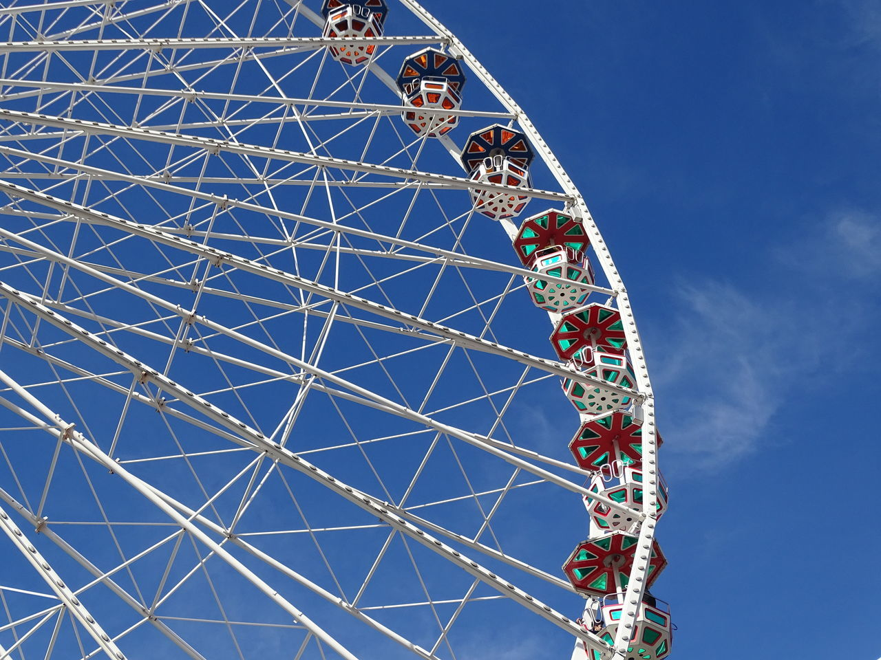 """A ferris wheel from below in the amusement park """"Prater"""" in Vienna Amusement Park Amusement Park Ride Attraction Big Wheel Blue Built Structure Carneval Clear Sky Day Entertainment Ferris Wheel Fun Fun Park Large Leisure Activity Low Angle View Metal Outdoors Park Prater Rotation Sky Vienna White Carnival Crowds And Details"""