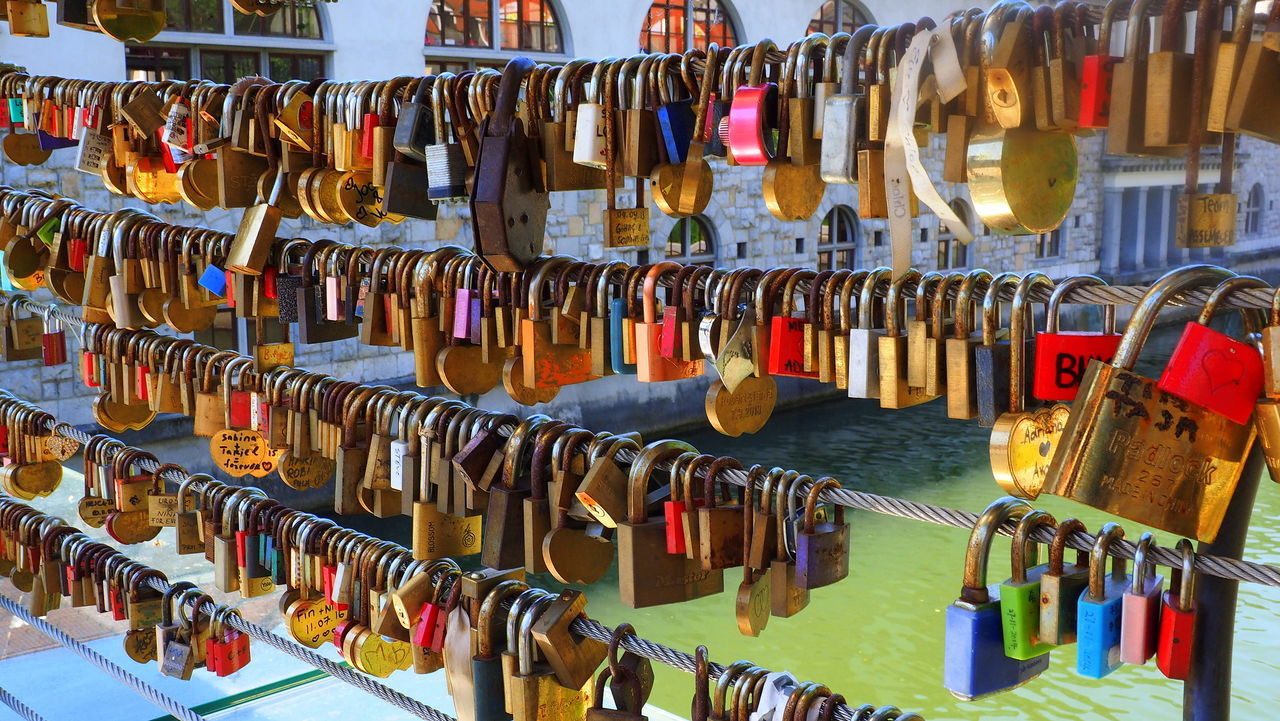 Bridge of lovelocks Bridge Close-up Hanging In A Row Large Group Of Objects Ljubljana, Slovenia Lock Love Lock Multi Colored No People Padlock