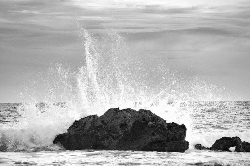 The forces of nature. (1/400, f/5.6, EV0, ISO400, 115(172)mm) Sea Wave Motion Power In Nature Nature Crash Beauty In Nature Water Force Rock - Object Breaking Breaking Waves Scenics Sky Blackandwhite Greyscale Monochrome Simplicity Waterfront Exceptional Photographs EyeEm Best Shots Light And Shadow Beautiful Tamron 70-200mm F/2.8 Pentax K-3
