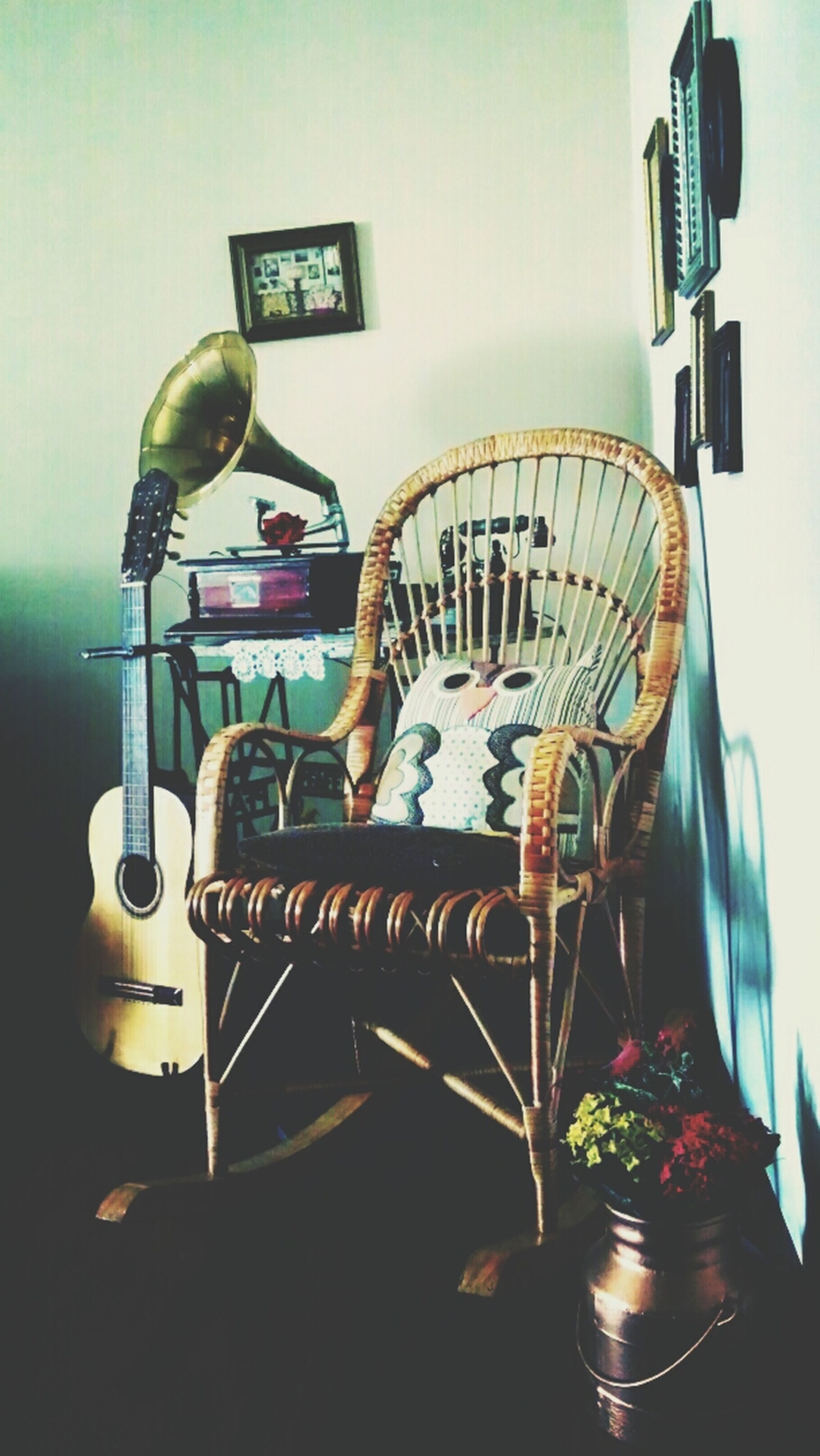 indoors, communication, technology, arts culture and entertainment, text, wall - building feature, chair, old-fashioned, built structure, home interior, reflection, architecture, lighting equipment, no people, western script, connection, hanging, music, musical instrument, retro styled