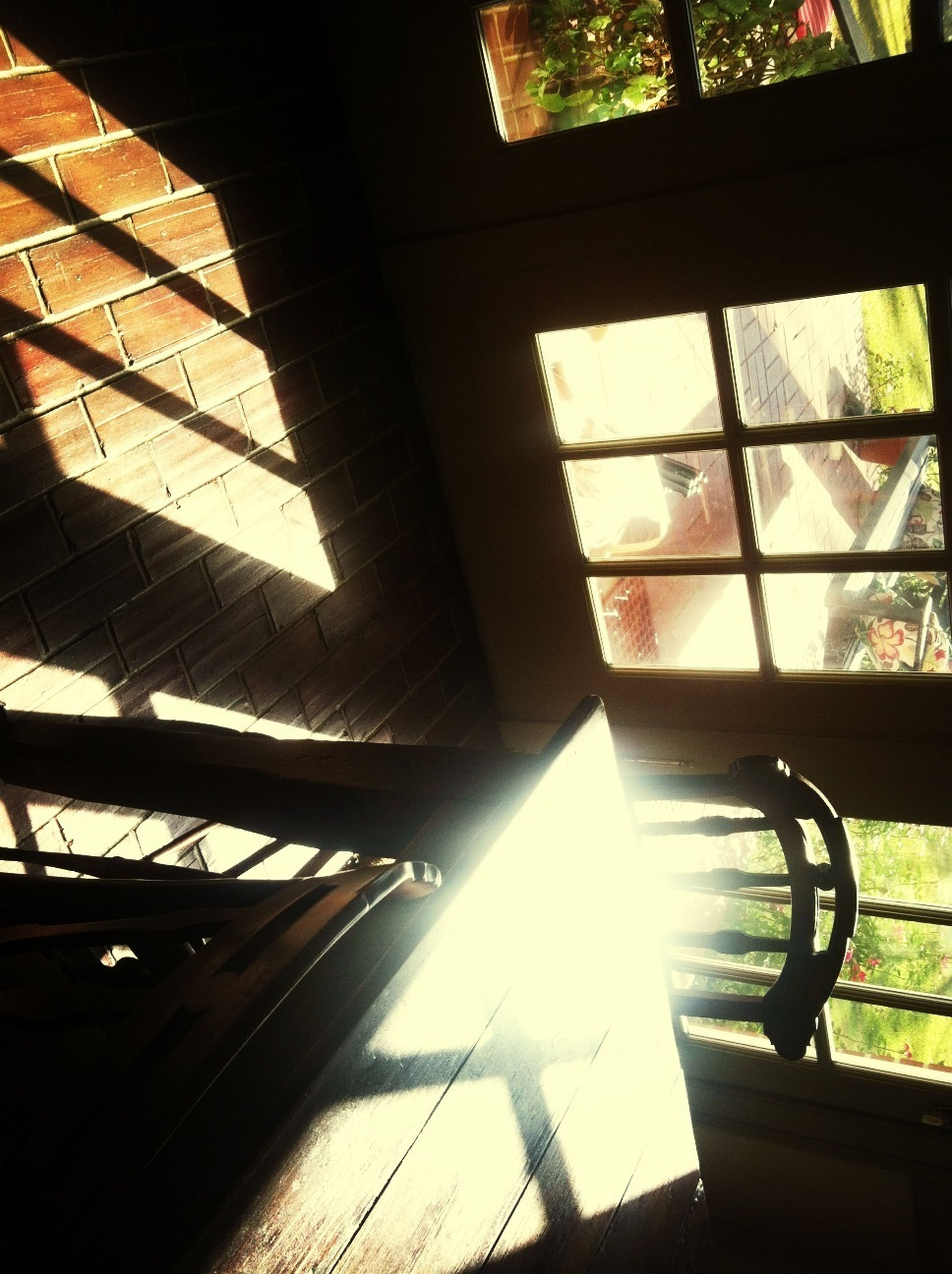sunlight, built structure, architecture, indoors, sunbeam, sun, low angle view, shadow, lens flare, window, railing, building exterior, glass - material, no people, day, sunny, building, silhouette, tree, shiny