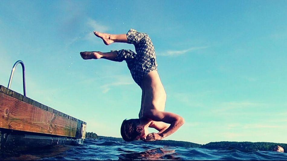 Sunny day. My boy jumping into the water Backwards Dive Jumping Jumping Shot Boy Kid Kids Kids Art Summer2016 Finland Summer Finland Enjoying Life