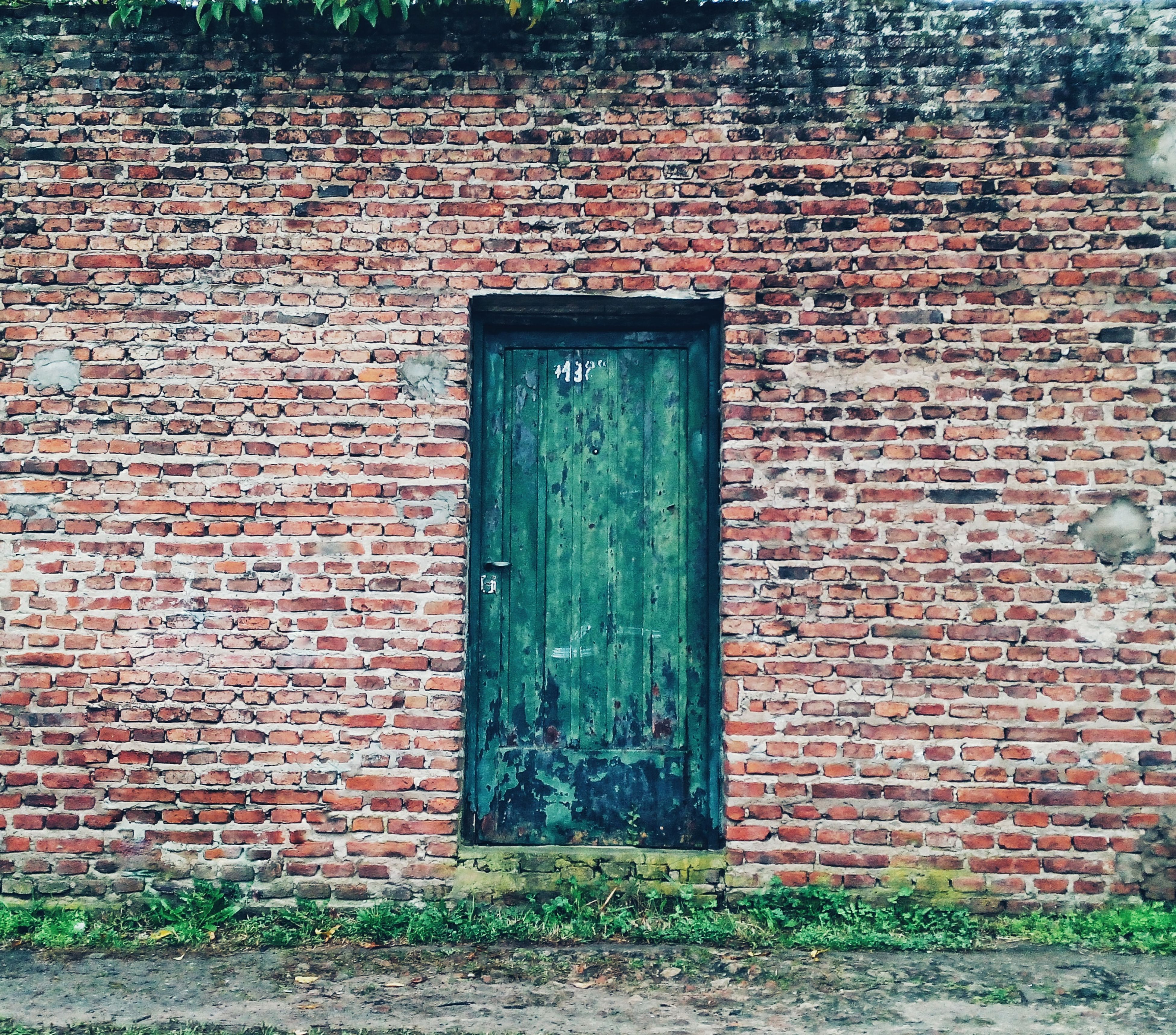building exterior, built structure, architecture, brick wall, window, wall - building feature, house, door, closed, wall, red, outdoors, day, safety, stone wall, old, no people, protection, weathered, security