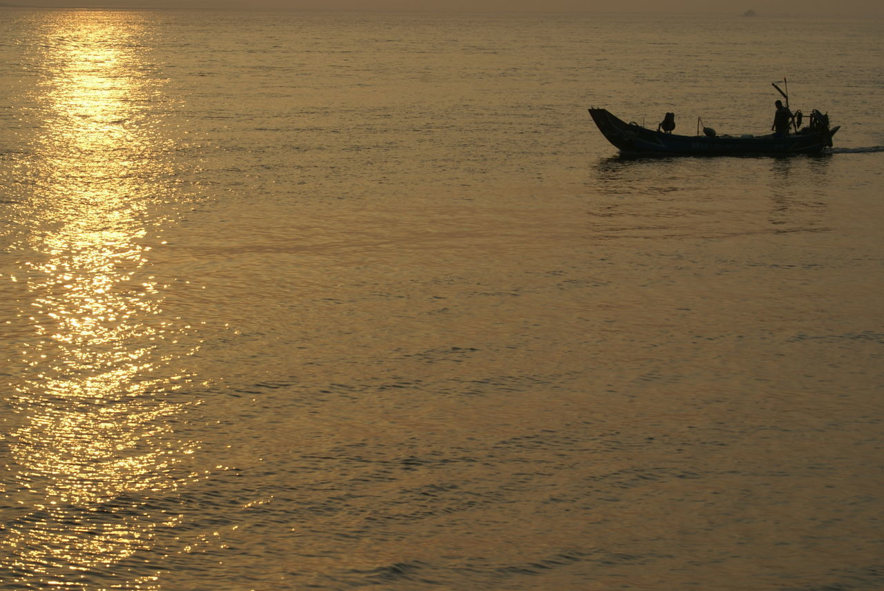 Beautiful Nature Beautiful Sunset Boat Coastline Escapism Fishing Boat Getting Away From It All Golden Slumbers Horizon Over Water My Best Photo 2015 Ocean Outdoors Recreational Pursuit Rippled Sea Seascape Ship Shore Sunset Surf Water Wave 43 Golden Moments The Journey Is The Destination On The Way