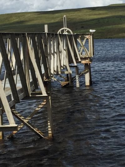 Jetty on Belmont reservoir, Lancashire Beauty In Nature Calm Idyllic Jetty Metal Metal Structure Bridge Mountain Nature Non-urban Scene Pier Remote Rippled Scenics Sky Tranquil Scene Tranquility Water