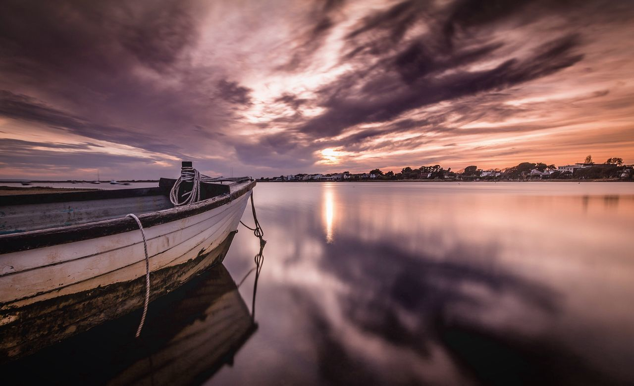 sky, cloud - sky, reflection, sunset, water, transportation, nautical vessel, no people, nature, mode of transport, beauty in nature, tranquil scene, tranquility, scenics, moored, outdoors, sea, architecture, day