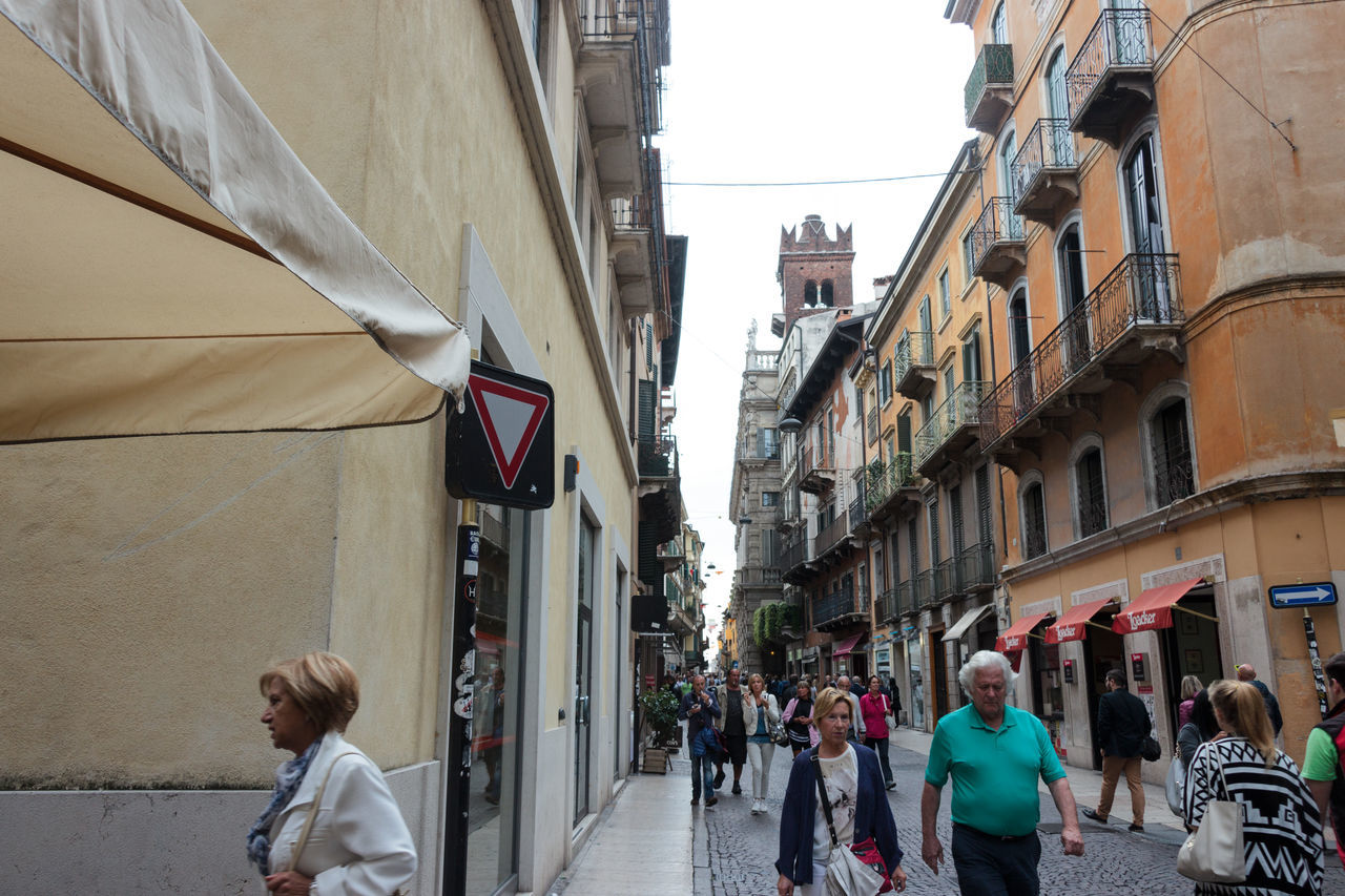 Verona, Italy - September 27, 2015 : Tourists walk along Via Rosa, inspect the sights and photograph them in Verona, Italy. Architecture Architecture Art Building City Culture Day Europe Famous History House Italy Landmark Old Outdoors People Square Street Tourism Town Travel Urban Verona View Walking