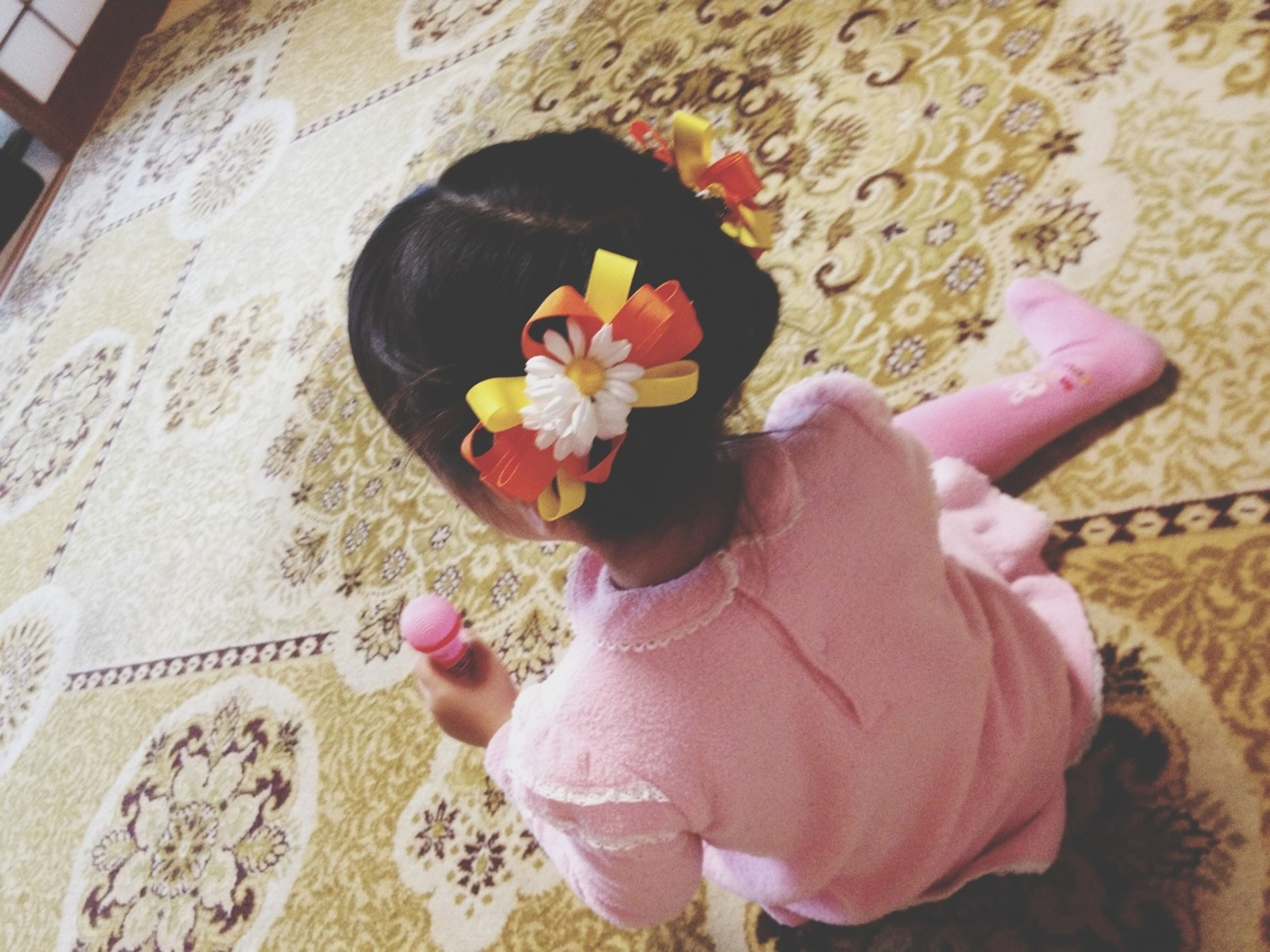 flower, lifestyles, leisure activity, holding, casual clothing, high angle view, childhood, person, girls, pink color, freshness, elementary age, petal, indoors, fragility, standing