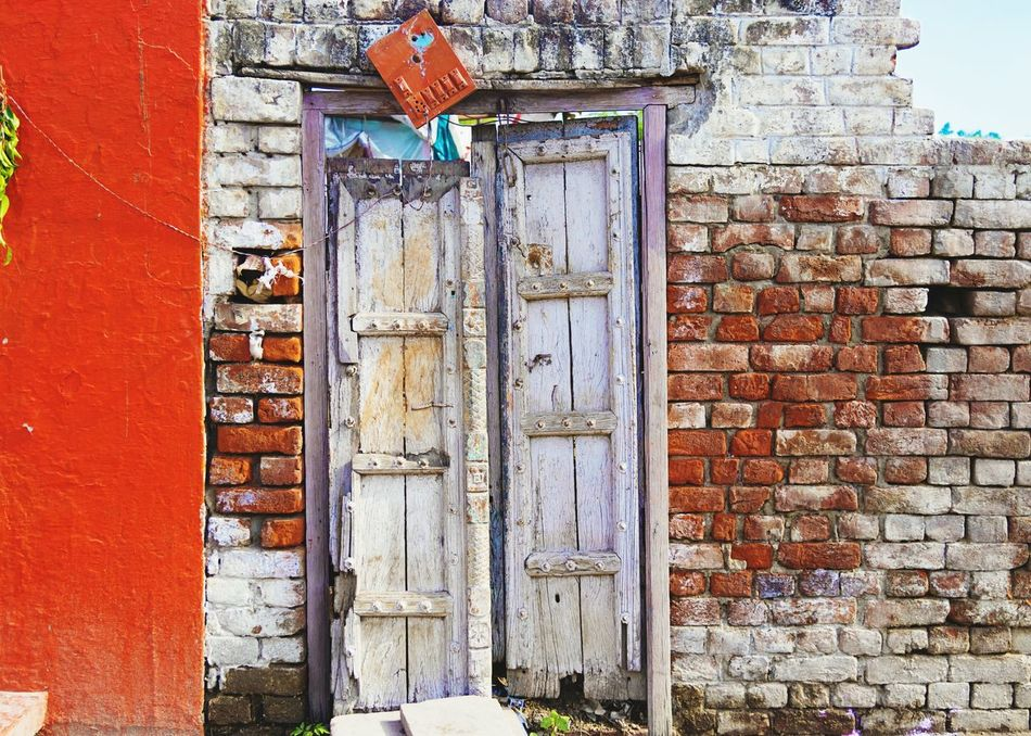 Red Eroded Red Bricks Built Structure Building Exterior Brick Wall Outdoors No People Day Switchboard Switches Electrical Wires Oldbuilding Ruins Doors