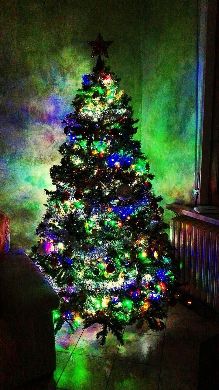 christmas, christmas tree, celebration, illuminated, christmas decoration, indoors, tradition, christmas lights, tree, night, holiday - event, christmas ornament, no people, multi colored, vacations