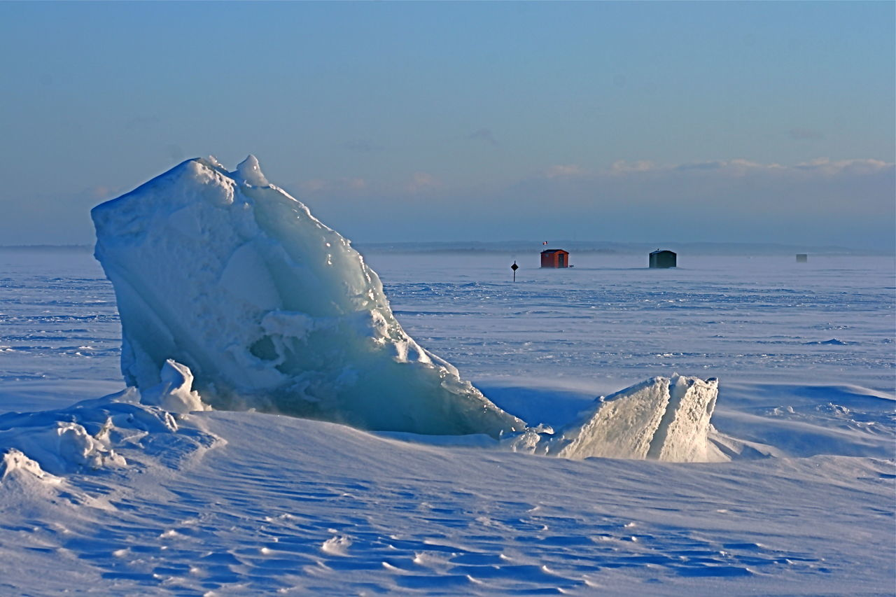 White Color New Snow Beauty In Nature Focus On Foreground Outdoors Snow Recreational Pursuit Small Ice Fishing Hut Ice Fishing Huts Composition