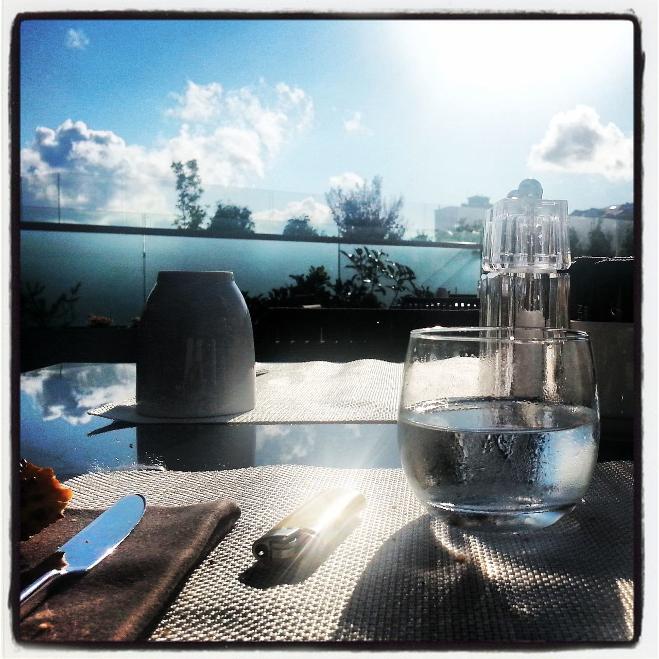sky, table, food and drink, window, no people, day, cloud - sky, drinking glass, refreshment, indoors, sunlight, drink, close-up, water, freshness